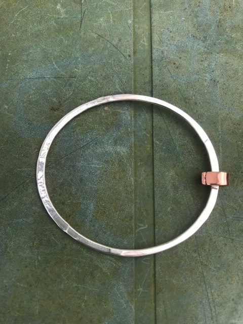 Silver 2.5mm hammered bangle with chunky copper 'free running' ring