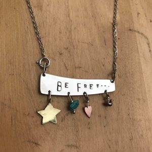 Silver 'Be Free' necklace - with brass , copper , bronze and turquoise charms.